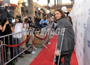 Matthew Gray-Gubler managing down the red carpet on crutches