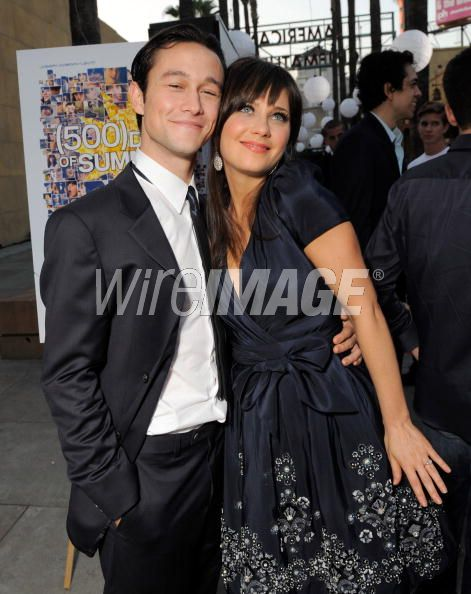 Joe Gordon-Levitt looking very happy to be posing with Zooey Deschanel